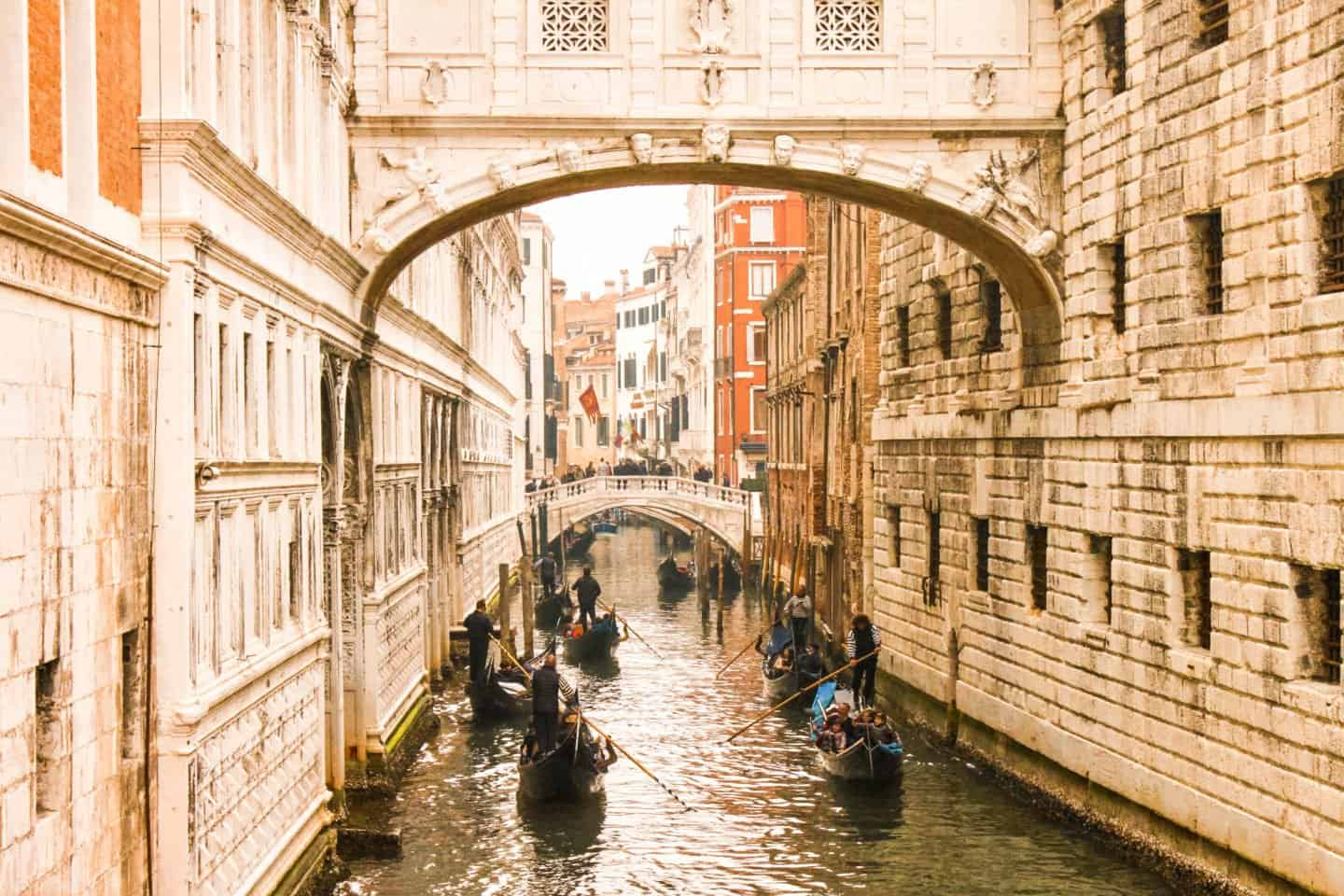 Travelling by gondola along the canals in Venice