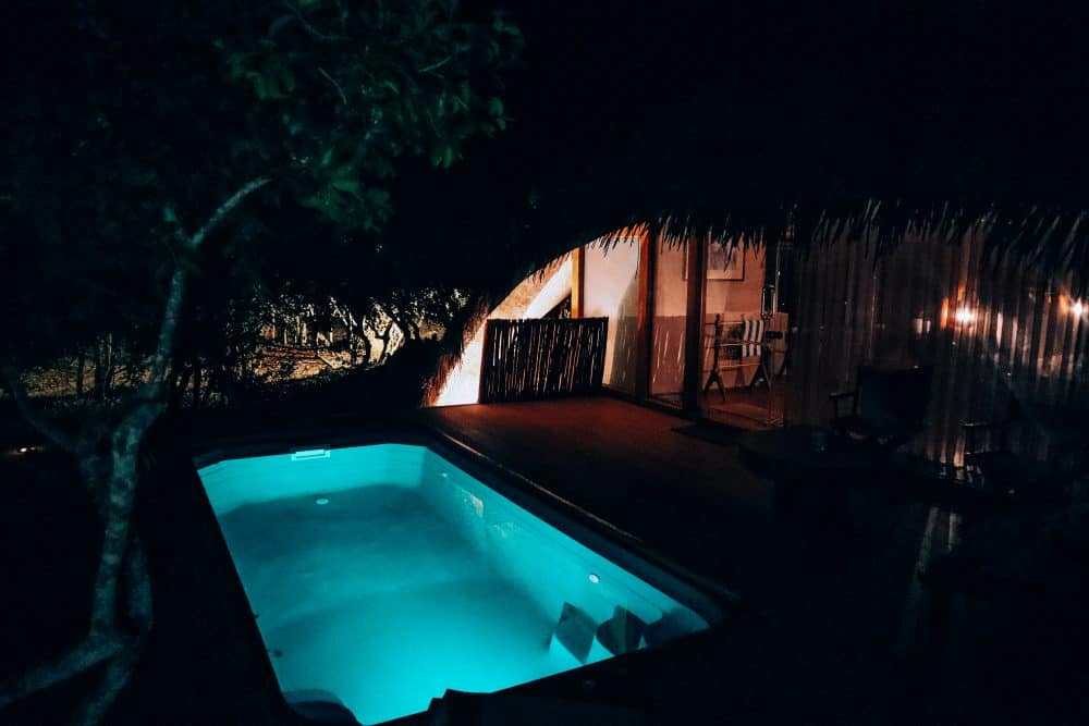 swimming in pool at night