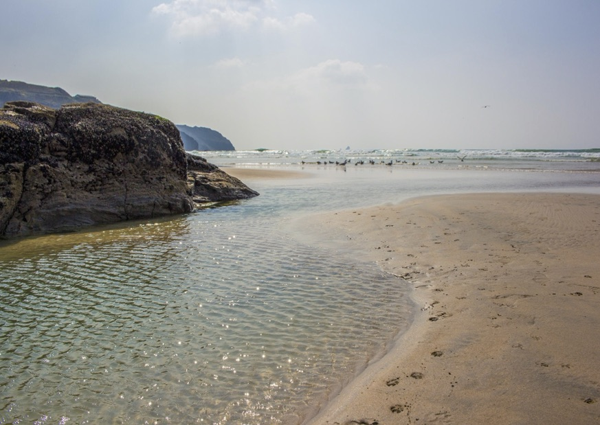 The shallow calm waters at Perranporth in Cornwall