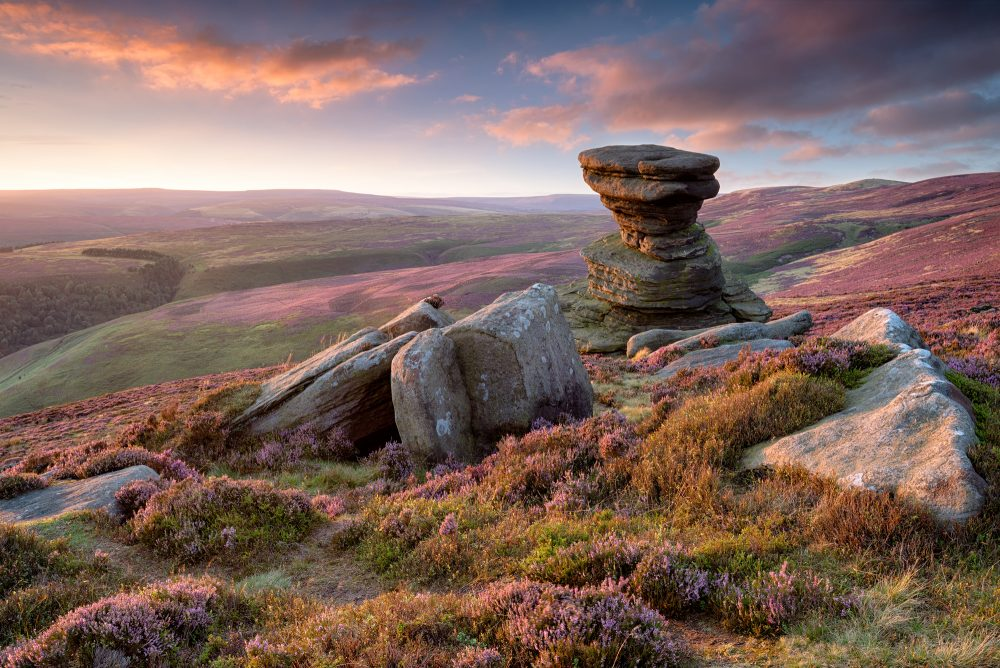 Stunning sunset over the Slat Cellar a weathered rock formation on Derwent Edge high above the Ladybower Reservoir in the Upper Derwent Valley in the Derbyshire Peak District