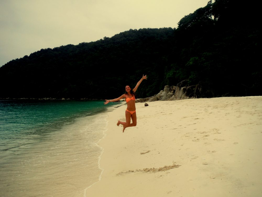 Jumping for joy in the Perhentian Islands, Malaysia, one of the best places to visit in Malaysia