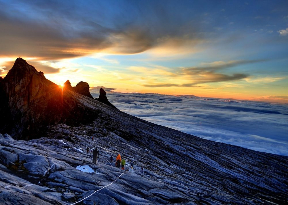 Hiking Mount Kinabalu at sunrise, one of the best places to visit in Malaysia